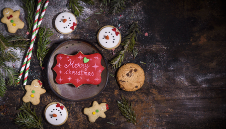 Merry Christmas cookies on the wooden background with blank space for ads
