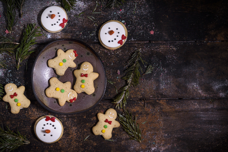 Christmas gingerbread cookies on the wooden background with blank space,selective focus