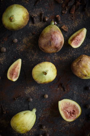 Group of raw figs served on the dark background,selective focus