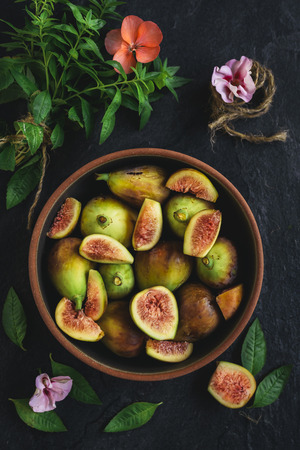 Raw figs in the bowl,selective focus