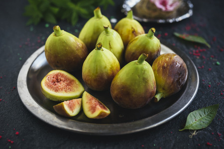 Raw figs served in the metal plate,selective focus