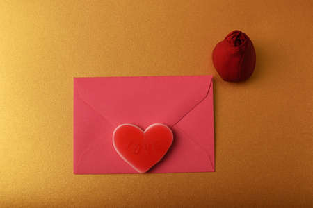 Envelope, red rosebud and heart. Symbol of love and romance