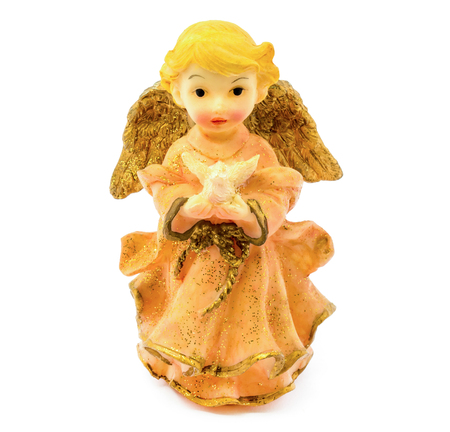 Photo of statuette of porcelain angel with pigeon isolated on white background