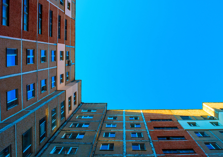 Photo of the top building corner with blue sky