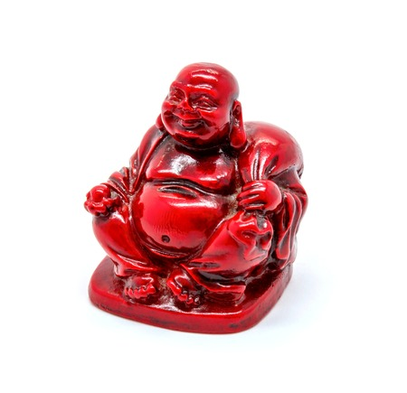 Photo of statuette of red buddha isolated on white background Stock Photo