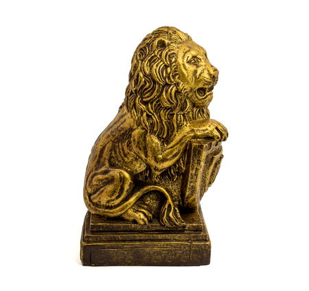 Photo of gold statuette of a lion with shield isolated on a white background