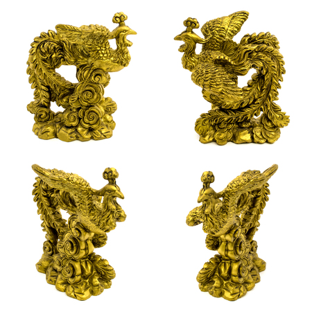Set of statuettes of gold pheasants isolated on a white background