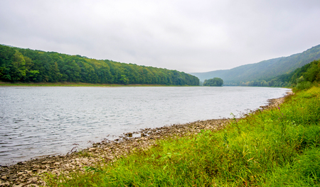 Photo of big beautiful river, view from beach