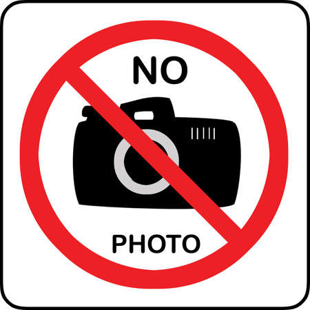 No photography allowed sign with text