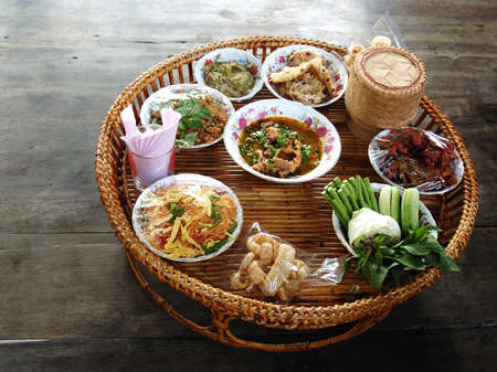 Khantoke, dinner set was popular in North of Thailand, particularly Chiang Mai.    Stock Photo
