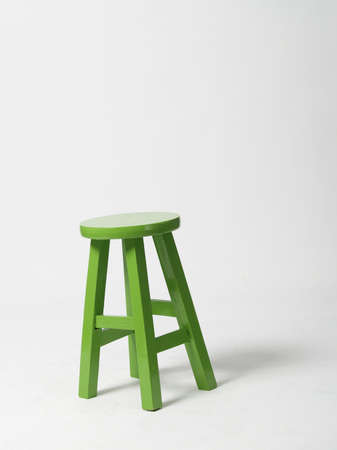 Green wooden chair isolated on white background.
