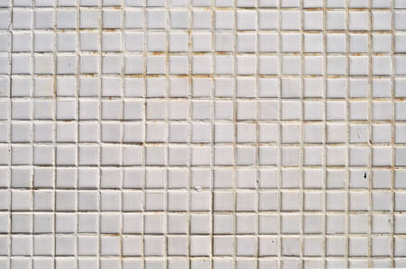 Grungy white square ceramic tiles texture