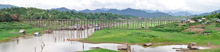 Panorama rural life view of wooden Mon bridge at Sangkhlaburi Kanchanaburi, Thailand  photo