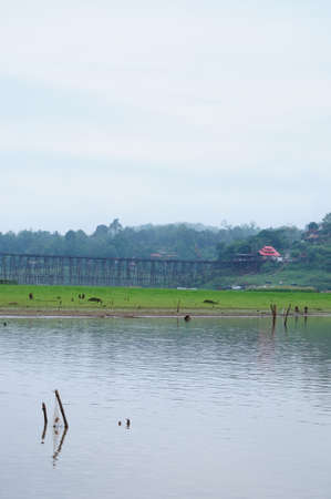 Sangkhlaburi natural life, which has the Mons bridge is background  photo