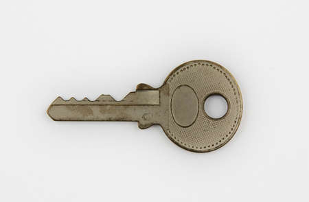 A silver key isolated on white background photo