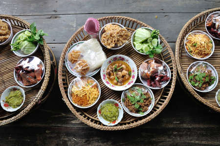 Kantoke, traditionally dinner set was popular in North of Thailand, particularly Chiang Mai   Stock Photo