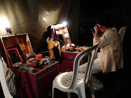 BANGKOK - DEC 10: A Chinese man makes up before playing Chinese opera December 10, 2008 in Bangkok.
