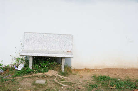 Marble bench and white wall at public park