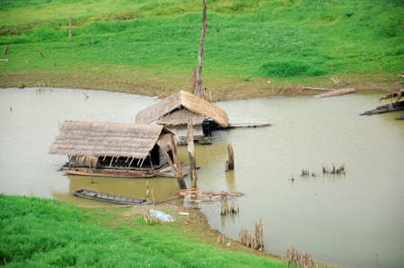 Two hut raft floating on river at Sangklaburi, Thailand