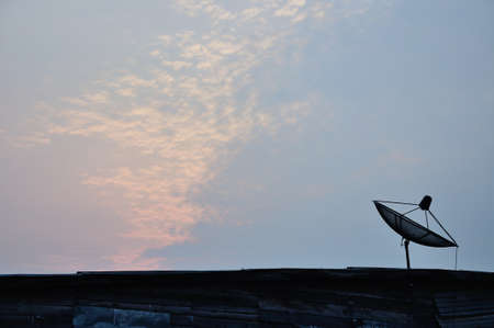 Silhouette of satellite dish antenna for television in the morning, Thailand  photo