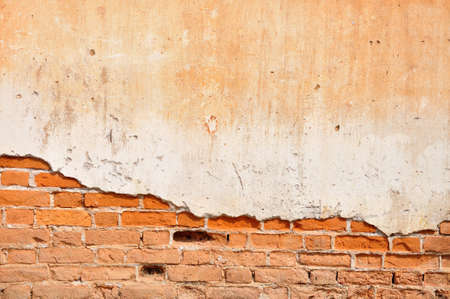 Red clay stained on the white exposed brick concrete wall  Reklamní fotografie