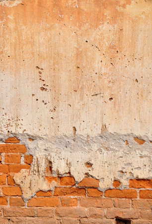 Red clay stained on the white exposed brick concrete wall  Stock Photo