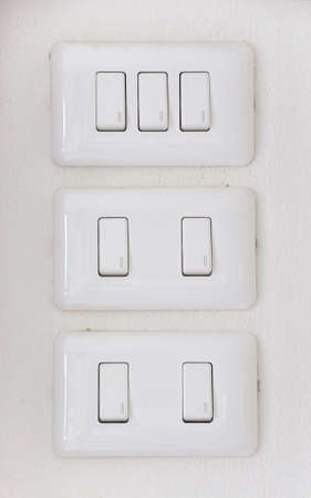 Lighting switch on white background  photo