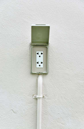 220 volt waterproof outdoor electrical power outlet at outside home wall