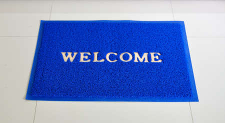 Blue welcome door mat on the floor  photo