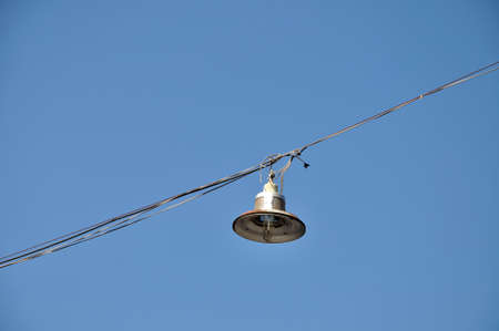 Outdoor hanging lamp on bluesky  photo