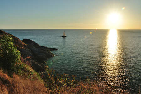 Beautiful sunset scenic from famous viewpoint at Promthep cape, Phuket Thailand  photo