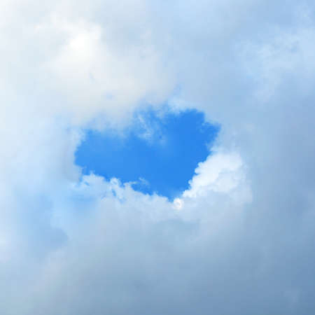 Heart shaped cloud in the blue sky  photo