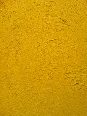 backdrop: Yellow exposed concrete wall. Stock Photo