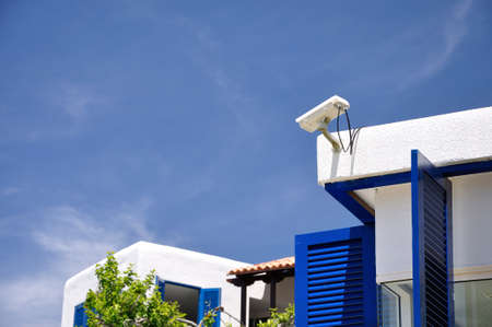 security monitoring: Security CCTV camera on the roof of resort