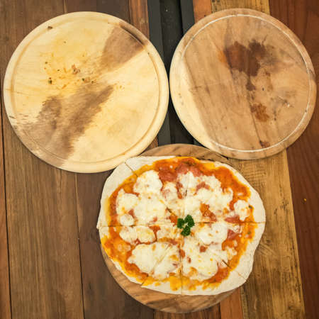 margarita pizza: Margarita pizza produces from wood fired oven and 2 empty pans arrange as micky mouse face