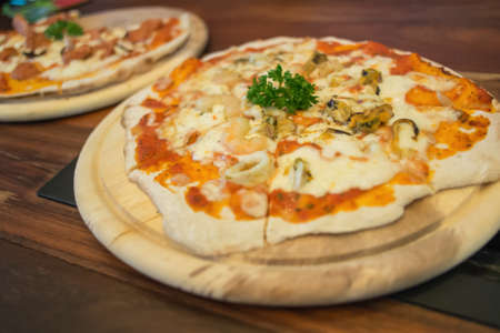 Seafood pizza produces from wood fired oven