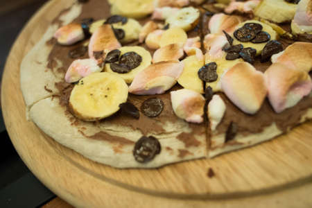 Dessert pizza with chocolate banana and marshmallow
