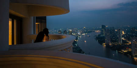 Couple in romantic night scene at 56th terrace of hotel  photo