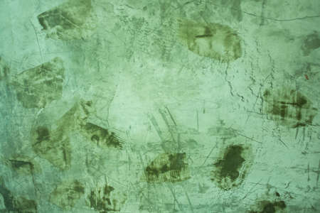 Green exposed grungy concrete wall  photo