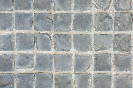 ladrillo: Textura del suelo de cemento expuesto en mosaico.
