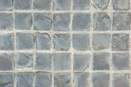 brick background: Texture of exposed cement floor tiled. Stock Photo