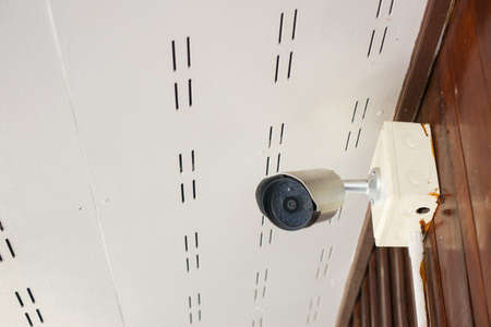 Security CCTV camera at wall in the home.