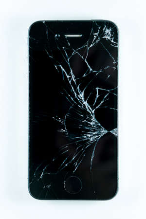 Broken screen mobile smartphone isolated on white background. Banque d'images