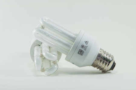 Compact-fluorescent light bulb isolated on white background. Stock Photo