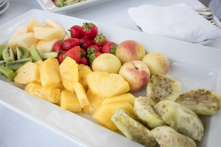 Fresh fruit range with peach, kiwi, pineapple, strawberries, ficodindia