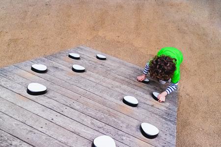 child climbing a playground game