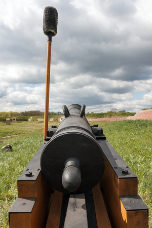 warzone: View of the carriage and old cannon barrel, which is leaning against a swab on the barrel. Stock Photo