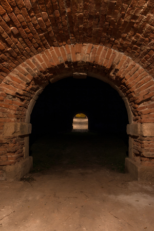 underground passage: Looking into bricks illuminate the old walled underground passage