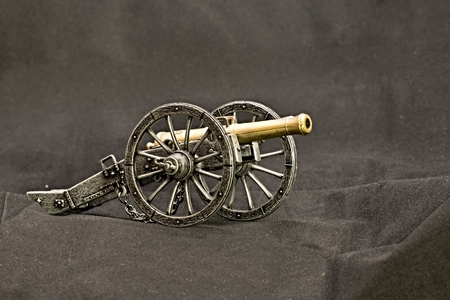 replica: Old metal replica guns and accessories on a dark background