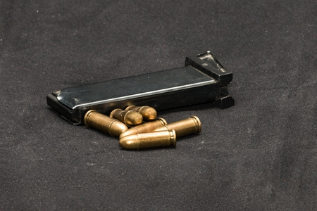 loosely: Magazine and several loosely laid pistol cartridges